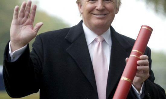 US tycoon Donald Trump is pictured as he recieves an Honorary award of Doctor of Business Administration at Robert Gordon University in Aberdeen, Scotland, on October 8, 2010. Trump is in the process of building a luxury golf development on the Menie estate on the Aberdeenshire coast. AFP PHOTO/DEREK BLAIR